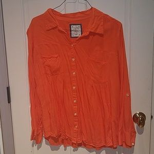 Beautiful tangerine colored button up blouse